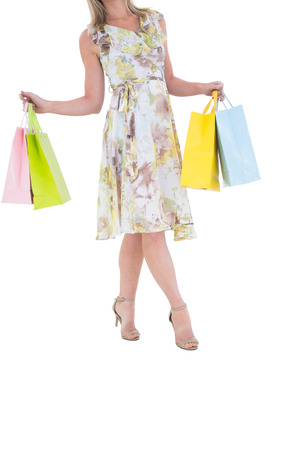gift spending: Elegant blonde with shopping bags on white background