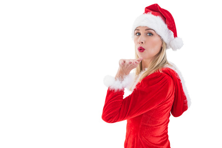 pere noel sexy: Blonds Festive soufflant un baiser sur fond blanc Banque d'images