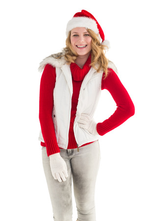 warm clothes: Smiling pretty blonde standing in warm clothes on white background Archivio Fotografico