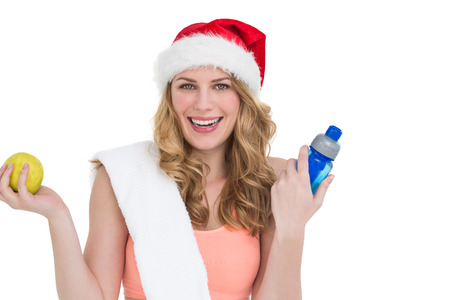Festive fit blonde smiling at camera on white background photo