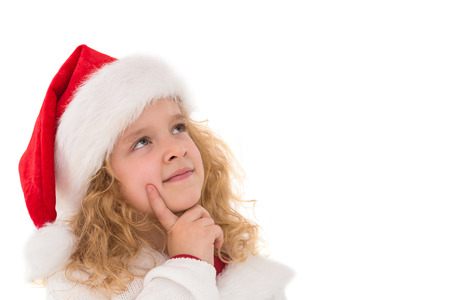 Festive little girl thinking and looking up on white background photo
