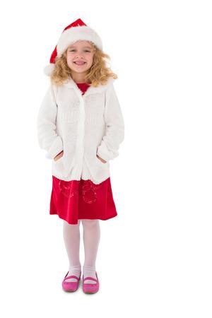 Festive little girl smiling at camera on white background photo