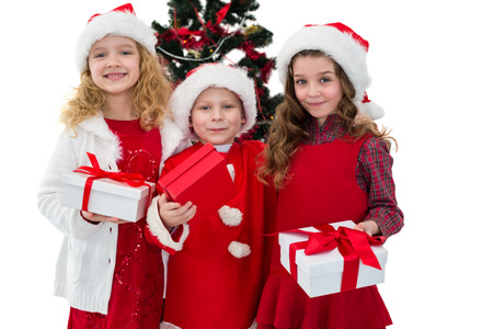 Festive little siblings holding gifts on white background photo