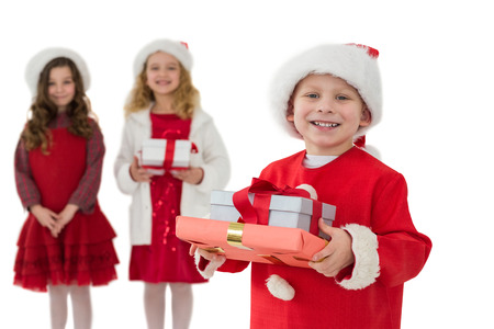 Festive little siblings smiling at camera holding gifts on white background photo