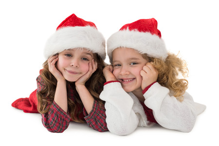 Festive little siblings smiling at camera on white background photo