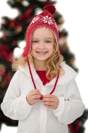 Festive little girl in hat and scarf on white background photo