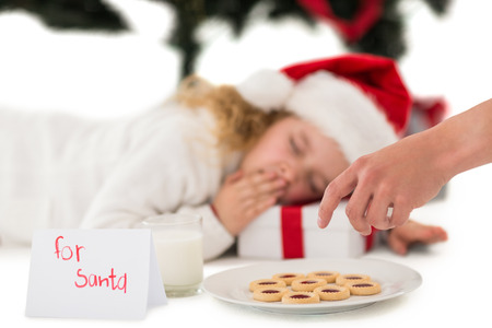 Festive little girl napping on a gift on white background photo