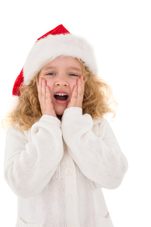 Festive little girl with hands on face on white background photo