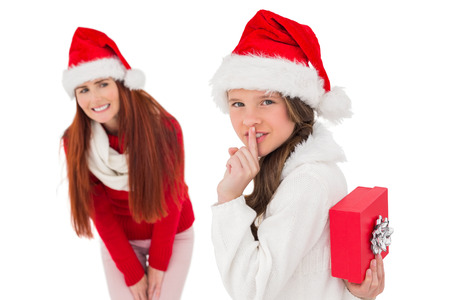 gift behind back: Mother and daughter with christmas gift on white background Stock Photo