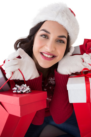 Happy brunette holding shopping bags full of gifts on white background photo