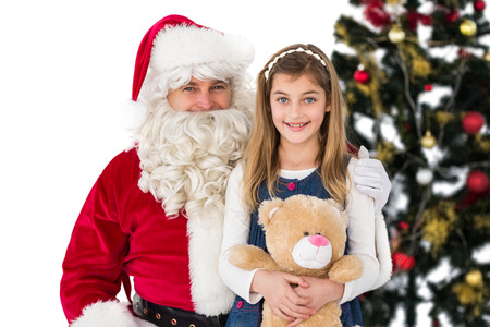 Little girl with santa claus on white background photo