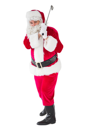 christmas golf: Cheerful santa claus playing golf on white background
