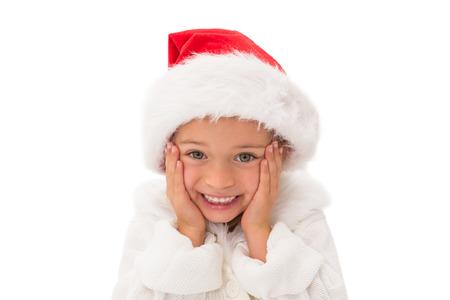 wearing santa hat: Cute little girl wearing santa hat  on white background Stock Photo