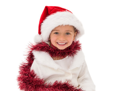 wearing santa hat: Cute little girl wearing santa hat and tinsel on white background Archivio Fotografico
