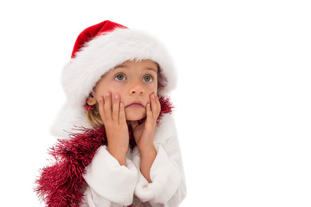 wearing santa hat: Cute little girl wearing santa hat and tinsel on white background Stock Photo