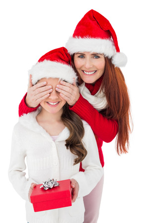 Festive mother surprising daughter with gift on white background photo