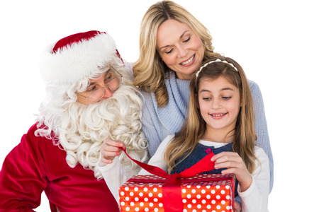 Mother and daughter with santa claus on white background photo