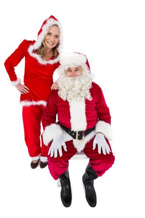 se�ora: Santa y se�ora Claus sonriendo a la c�mara sobre fondo blanco Foto de archivo