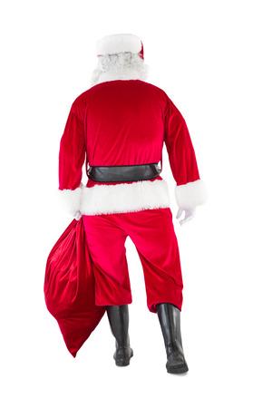 viejito pascuero: Vista trasera de Pap� Noel que sostiene un saco en el fondo blanco