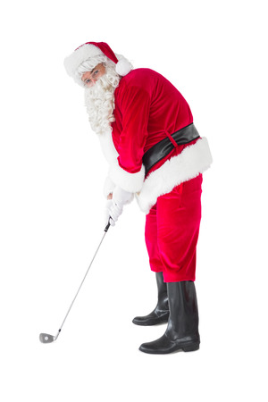 christmas golf: Happy santa claus playing golf on white background