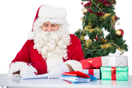Happy santa writing letter for gifts on white background photo