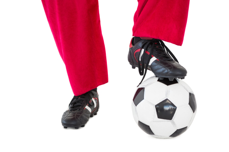 football boots: Lower half of santas legs with football boots and football on white background Stock Photo