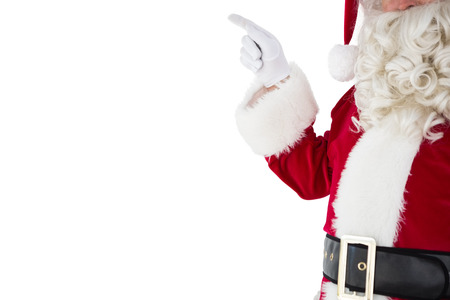 Mid section of santa pointing on white background