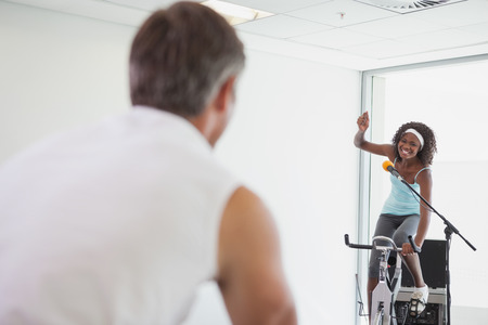 motivating: Spinning instructor motivating her class at the gym Stock Photo