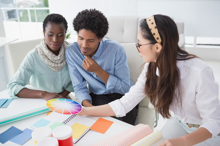 interior designer: Interior designer speaking with clients in creative office