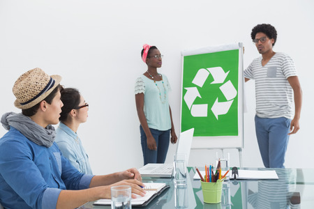 environmental conversation: Young creative team having a meeting about recycling in creative office