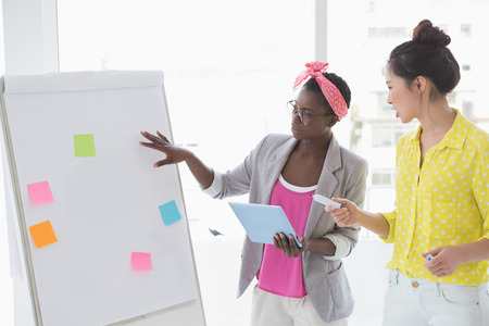 Young creative women brainstorming together in creative office photo