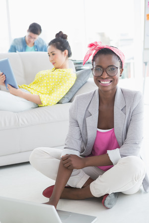 Young creative woman working on floor in creative office photo