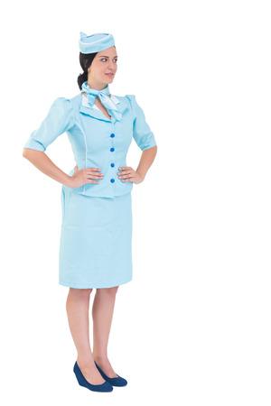hotesse avion: H�tesse de l'air Jolie avec les mains sur les hanches sur fond blanc Banque d'images