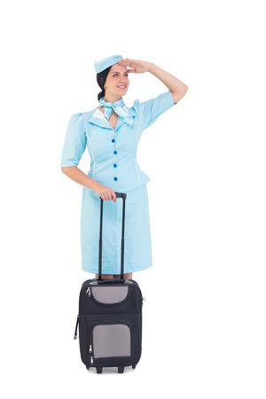 hotesse de l air: Jolie h�tesse de l'air tenue valise sur fond blanc