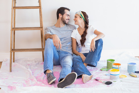 Cute couple redecorating living room in their new home Stock Photo