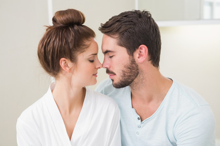 touching noses: Young couple touching their noses at home in the bathroom Stock Photo