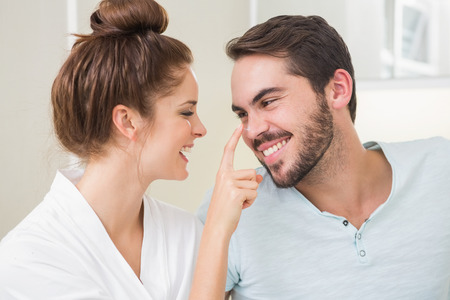 couple bathroom: Young woman touching her boyfriends nose at home in the bathroom Stock Photo