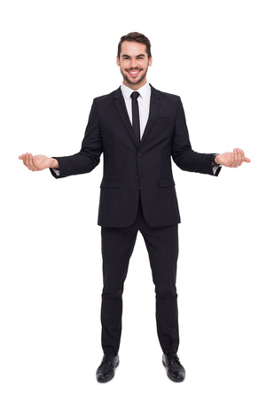 young man short hair: Happy businessman with his open hands on white background
