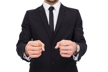 clenching: Elegant businessman in suit clenching his fists on white background