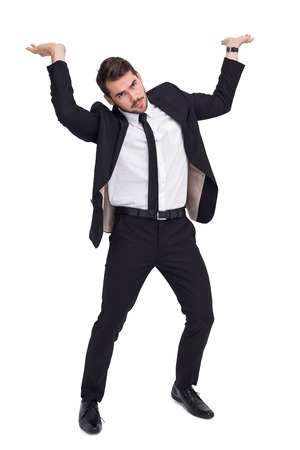 Businessman in suit lifting up something heavy on white background