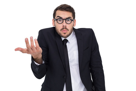 business skeptical: Doubtful businessman with glasses gesturing on white background