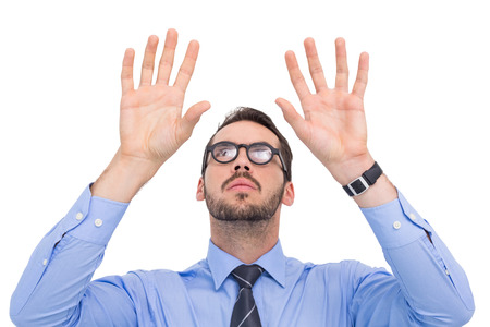 Businessman with arms raised and his fingers spread out on white background photo