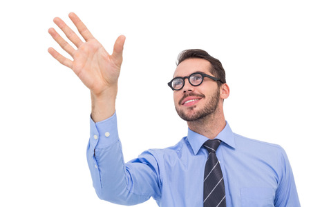 Smiling businessman standing with fingers spread out on white background photo