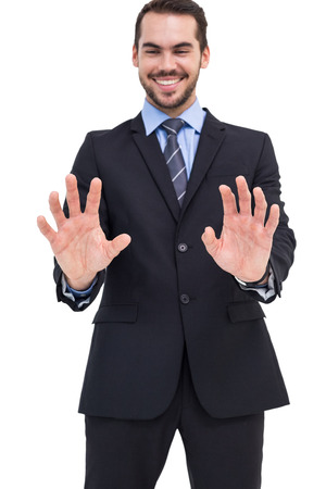 Happy businessman presenting his hands on white background photo