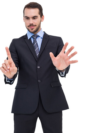 Businessman presenting number six with his fingers on withe background photo
