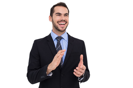 Happy businessman standing and clapping on white background