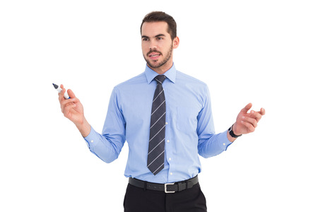 young adult men: Businessman holding marker and gesturing on white background