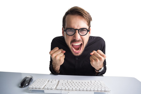 young adult men: Businessman cheering in front of his computer on white background