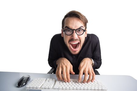 euphoria: Excited businessman typing on keyboard on white background