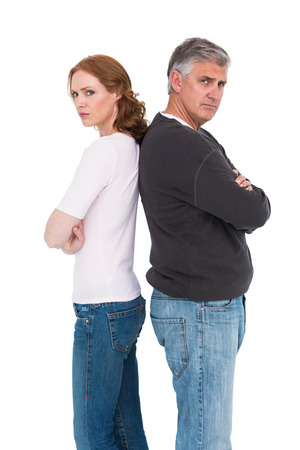 Casual couple not speaking after fight on white background photo